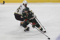 Minnesota Wild's Mats Zuccarello (36) sneaks the puck away from Vegas Golden Knights' Keegan Kolesar (55) in the first period of an NHL hockey game, Monday, March 8, 2021, in St. Paul, Minn. (AP Photo/Stacy Bengs)