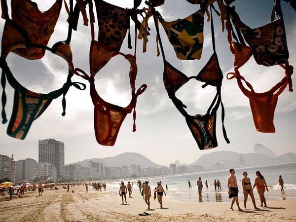 """<b>Rio de Janeiro, Brazil </b><br>The city that spawned Carnival and """"The Girl from Ipanema"""" has a buzzing beach scene throughout its 25 miles (40 kilometers) of shoreline, from Copacabana— where bronzed Cariocas clad in skimpy swimwear and Havaianas stroll the wave-patterned promenade in the shadow of Christ the Redeemer—to the more upscale Ipanema, framed by the Rio skyline and the rocky peaks of Dois Irmãos (Two Brothers)."""
