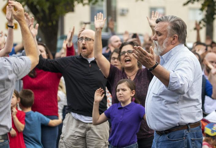 Pastor Douglas Wilson leads others at a protest in Moscow, Idaho.