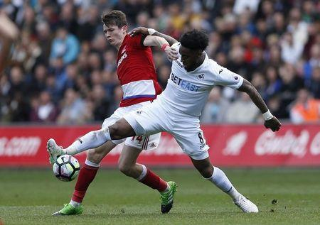 "Britain Football Soccer - Swansea City v Middlesbrough - Premier League - Liberty Stadium - 2/4/17 Middlesbrough's Marten de Roon in action with Swansea City's Leroy Fer Action Images via Reuters / Andrew Boyers Livepic EDITORIAL USE ONLY. No use with unauthorized audio, video, data, fixture lists, club/league logos or ""live"" services. Online in-match use limited to 45 images, no video emulation. No use in betting, games or single club/league/player publications. Please contact your account representative for further details. - RTX33Q9H"