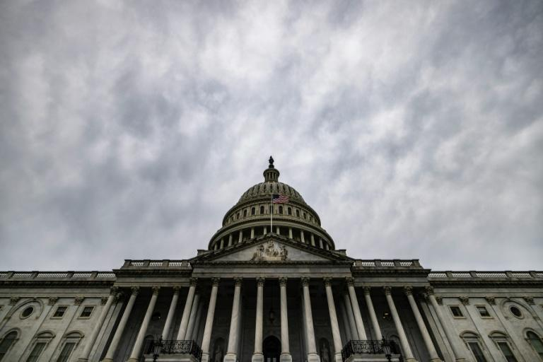 Fights over the country's debt limit have become common in the US Congress (AFP/Samuel Corum)