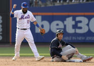 New York Mets shortstop Luis Guillorme (13) reacts as Atlanta Braves' Freddie Freeman, right, is out at second base after Braves' Austin Riley grounded into a double play during the third inning of the first game of a baseball doubleheader Monday, July 26, 2021, in New York. (AP Photo/Bill Kostroun)