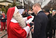 In this adorable moment, William passed on Prince George's Christmas Wish List to Santa Claus as he visits Esplanade Park's Christmas market in Helsinki. (Dominic Lipinski/PA Images)