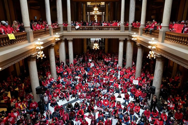 Educators and their supporters gather in the Capitol Building as teachers hold a one day walkout at the statehouse in Indianapolis