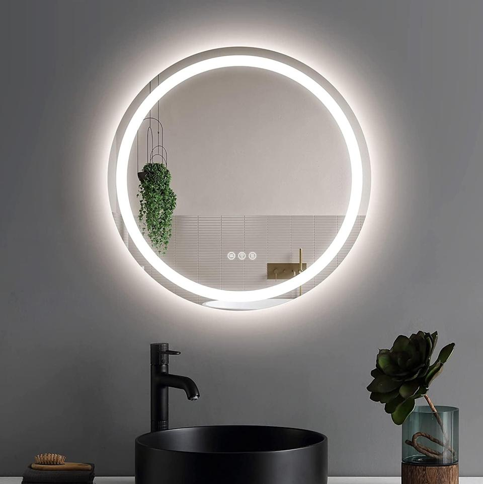 <p>Level up your bathroom and give it a modern look with the <span>LED Bathroom Vanity Mirror</span> ($200). It's has an LED light border that is dimmable and comes in three color settings. Also, the mirror is antifog, and who doesn't love that?</p>