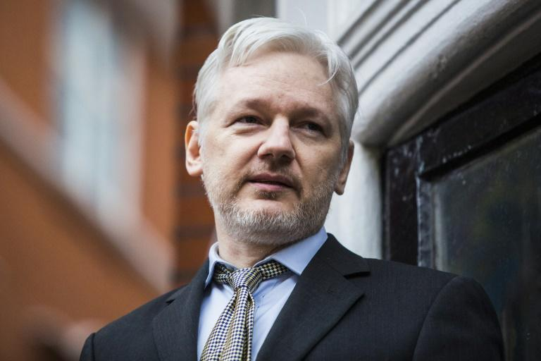 The future of WikiLeaks founder Julian Assange, seen last year addressing the media from the balcony of the Ecuadorian embassy in central London, remains unclear as Swedish prosecutors drop a seven-year rape investigation