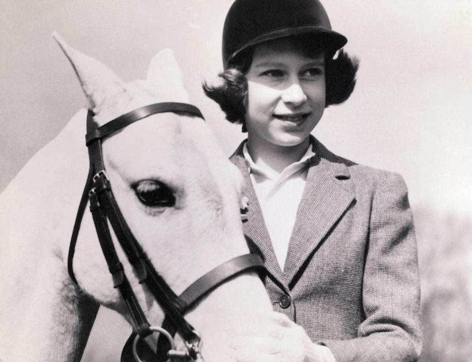 Crown Princess Elizabeth of Great Britain, later Queen Elizabeth II, with her pony, at age 10.