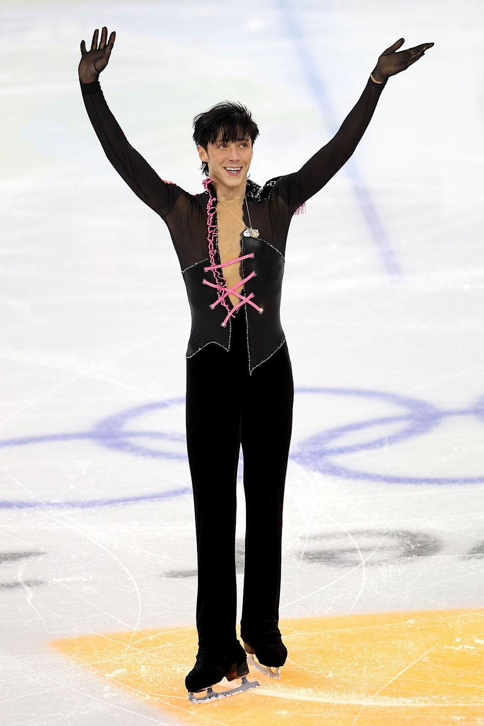 Johnny Weir wearing a corseted top at the olympics in 2010.