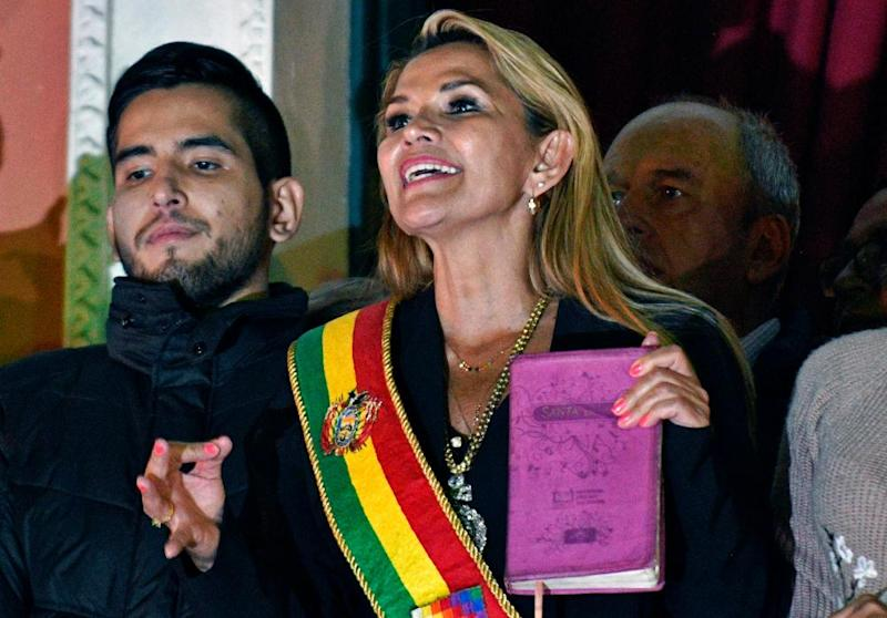 Bolivia's self-proclaimed interim president, Jeanine Áñez, a conservative Christian, speaks from the balcony of the Quemado Palace in La Paz with a Bible in hand.
