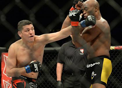 Nick Diaz punches at Anderson Silva during their UFC 183 fight. (USAT)