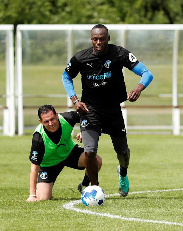 Soccer Football - England & Soccer Aid World XI Training - Motspur Park, London, Britain - June 8, 2018 Soccer Aid World XI's Usain Bolt during training Action Images via Reuters/Andrew Boyers
