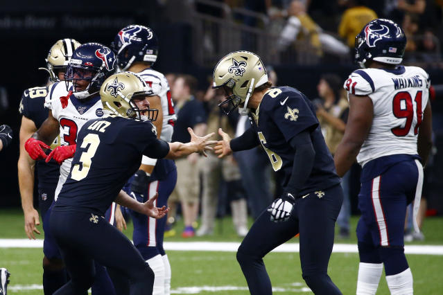 New Orleans Saints kicker Wil Lutz celebrates his game winning 58-yard field goal with holder Thomas Morstead (6) at the end of regulation in the second half of an NFL football game against the Houston Texans in New Orleans, Monday, Sept. 9, 2019. The Saints won 30-28. (AP Photo/Butch Dill)