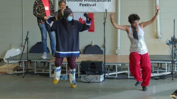 Dancers come together for Canadian Multiculturalism Day hosted by the Tombolo Multicultural Festival at the St. John's Farmer's Market. (Emma Grunwald/CBC - image credit)