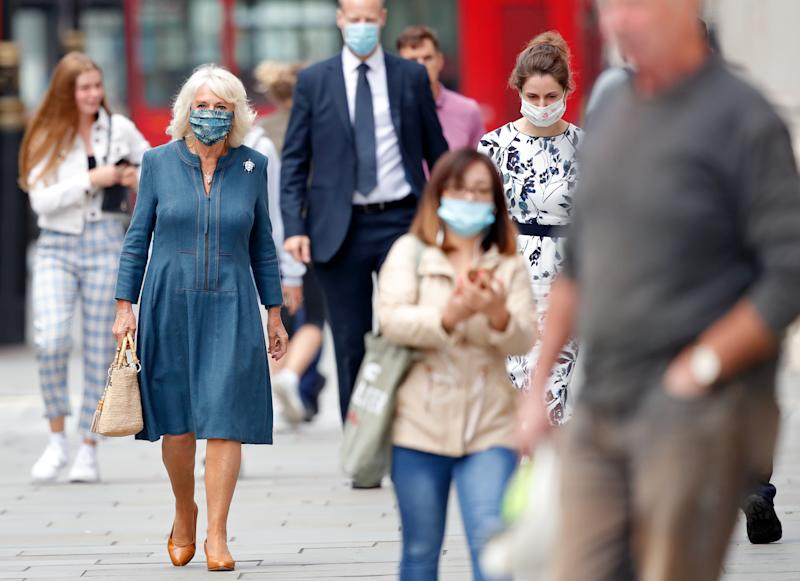 LONDON, UNITED KINGDOM - JULY 28: (EMBARGOED FOR PUBLICATION IN UK NEWSPAPERS UNTIL 24 HOURS AFTER CREATE DATE AND TIME) Camilla, Duchess of Cornwall (seen wearing a peacock feather patterned face mask) visits the recently reopened National Gallery to meet with staff involved in the organisation's Covid-19 response and reopening process on July 28, 2020 in London, England. The National Gallery, which was closed for 111 days due to the coronavirus pandemic, was the first major national art museum to reopen in the UK. (Photo by Max Mumby/Indigo/Getty Images)