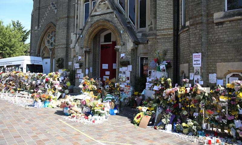 Tributes to the victims in the street outside Notting Hill Methodist church