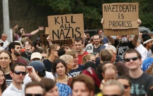 Thousands of anti-racism demonstrators flooded the streets of Boston Saturday, dwarfing a gathering of white nationalists in the city and triggering scuffles with police but avoiding the serious violence that marred a similar event a week earlier in Virginia.