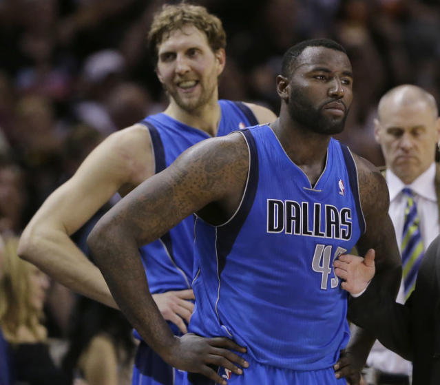 Dallas Mavericks' Dirk Nowitzki, left, of Germany, and Dallas Mavericks' DeJuan Blair, right, wait to enter the game after a time out during the first half of Game 7 of the opening-round NBA basketball playoff series against the San Antonio Spurs, Sunday, May 4, 2014, in San Antonio. (AP Photo/Eric Gay)