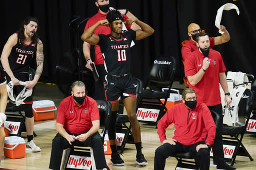 Texas Tech forward Tyreek Smith (10) reacts on the bench during the first half of an NCAA college basketball game against Iowa State, Saturday, Jan. 9, 2021, in Ames, Iowa. (AP Photo/Charlie Neibergall)