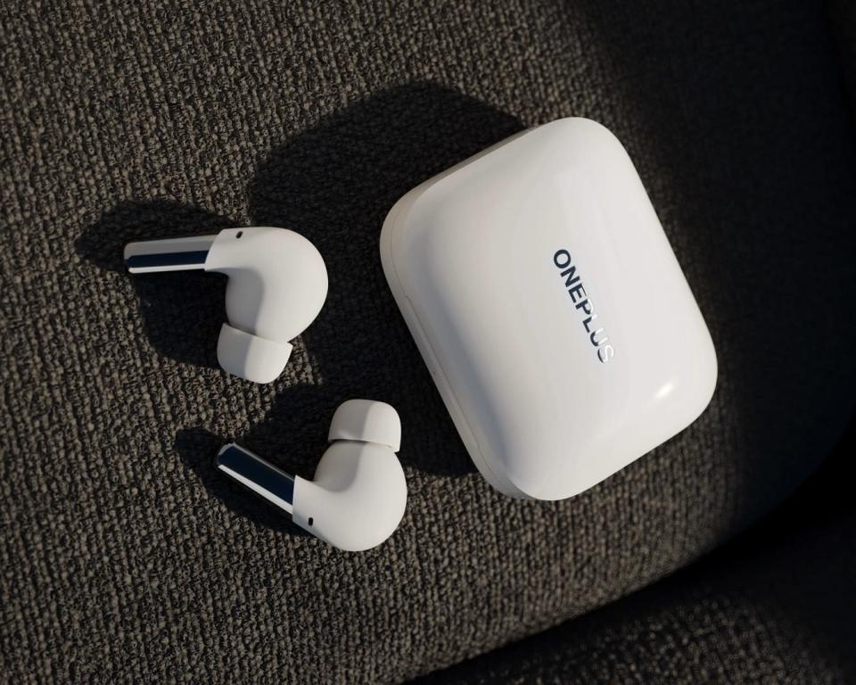 White OnePlus Buds Pro earphones with matching charging case. - Credit: OnePlus