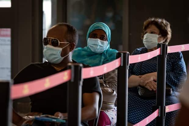 Transit riders in Toronto wait to be cleared after getting doses of COVID-19 vaccine at a pop-up clinic last week. (Evan Mitsui/CBC - image credit)