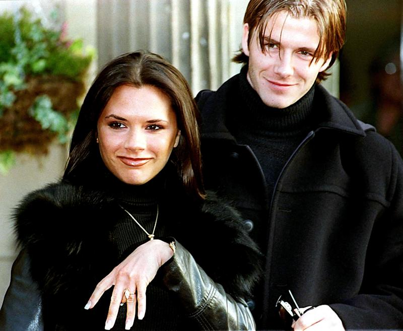The couple in matching black turtlenecks as they announce their engagement in 1998.