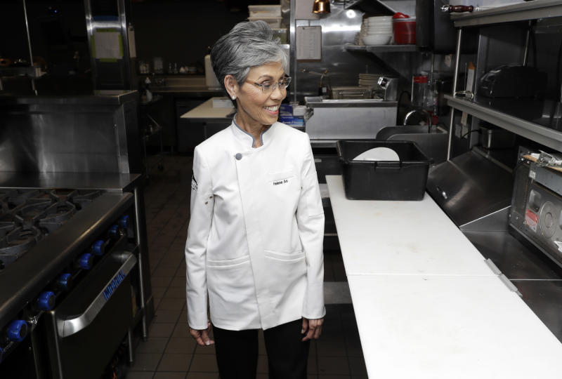 Helene An walks in the kitchen of her family's restaurant Crustacean Beverly Hills, Monday, May 13, 2019, in Beverly Hills, Calif. On May 18, the Smithsonian Asian Pacific American Center launches a $25 million fundraising drive for permanent gallery space on the National Mall in Washington, D.C. with a glitzy party in Los Angeles full of celebrities and politicians. (AP Photo/Marcio Jose Sanchez)