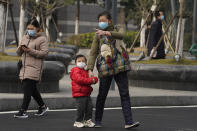 Residents wearing masks to help curb the spread of the coronavirus in Wuhan, China, on Tuesday, Jan. 26, 2021. The central Chinese city of Wuhan where the coronavirus was first detected has largely returned to normal but is on heightened alert against a resurgence as China battles outbreaks elsewhere in the country. (AP Photo/Ng Han Guan)