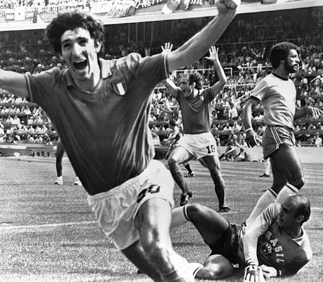 FILE - In this July 5, 1982 file photo, Italy's Paolo Rossi, left, celebrates, after scoring the second goal for his team during their World Cup match second round soccer match against Brazil, in Barcelona, Spain. Italy, who beat Brazil 3-2 in a classic match, went on to win the tournament with Rossi scoring six goals. The 21st World Cup begins on Thursday, June 14, 2018, when host Russia takes on Saudi Arabia. (AP Photo/File)