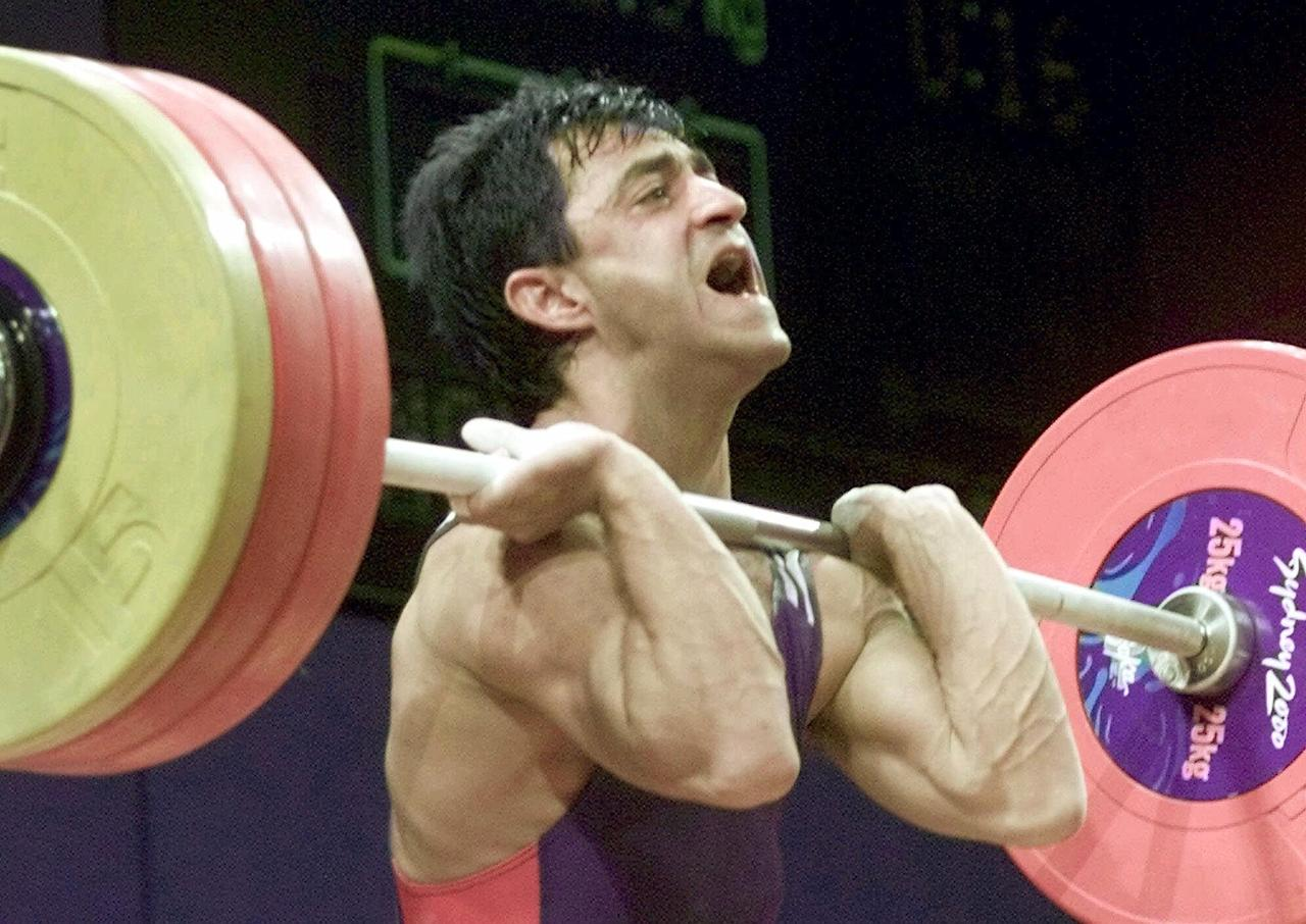 A positive test for a banned diuretic cost Bulgarian weightlifter Ivan Ivanov the silver medal at the 2000 Sydney Games in the 56-kilogram weight class. (AP Photo/David Guttenfelder)