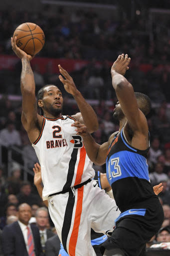 Los Angeles Clippers forward Kawhi Leonard, left, shoots as Cleveland Cavaliers center Tristan Thompson defends during the second half of an NBA basketball game Tuesday, Jan. 14, 2020, in Los Angeles. The Clippers won 128-103. (AP Photo/Mark J. Terrill)