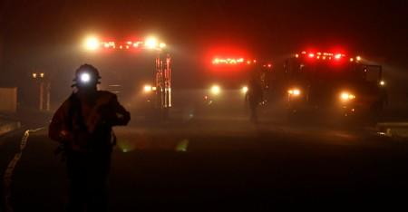 Firefighters battle a wind-driven wildfire called the Saddle Ridge fire in the early morning hours Friday in Porter Ranch