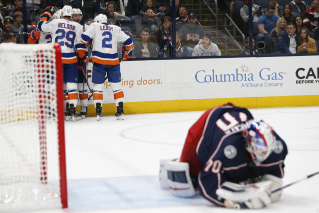 New York Islanders players celebrate their goal against Columbus Blue Jackets' Joonas Korpisalo, of Finland, during the first period of an NHL hockey game Saturday, Oct. 19, 2019, in Columbus, Ohio. (AP Photo/Jay LaPrete)