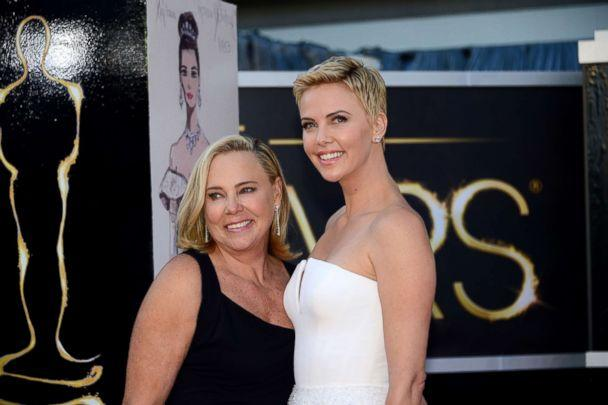 PHOTO: Charlize Theron and her mother arrive on the red carpet for the 85th Annual Academy Awards, Febr. 24, 2013, in Hollywood, Calif. (Frederic J. Brown/AFP/Getty Images)