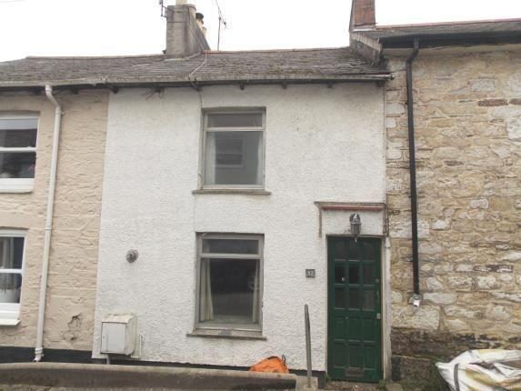 """<p>Looking for an investment project? This white-stone Cornish home might be situated in the charming seaside town of Penryn, but it's in desperate need of some TLC. </p><p><a href=""""https://www.zoopla.co.uk/for-sale/details/57791595/"""" rel=""""nofollow noopener"""" target=""""_blank"""" data-ylk=""""slk:This property is currently on the market for £157,500 with Miller Countrywide via Zoopla."""" class=""""link rapid-noclick-resp"""">This property is currently on the market for £157,500 with Miller Countrywide via Zoopla.</a><br></p>"""