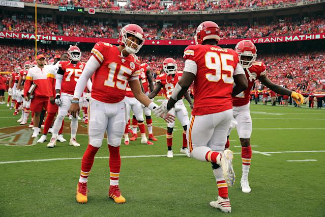 Kansas City Chiefs quarterback Patrick Mahomes greets defensive end Chris Jones before a 2019 against the Baltimore Ravens at Arrowhead Stadium in Kansas City, Missouri. (Photo by Jamie Squire/Getty Images)