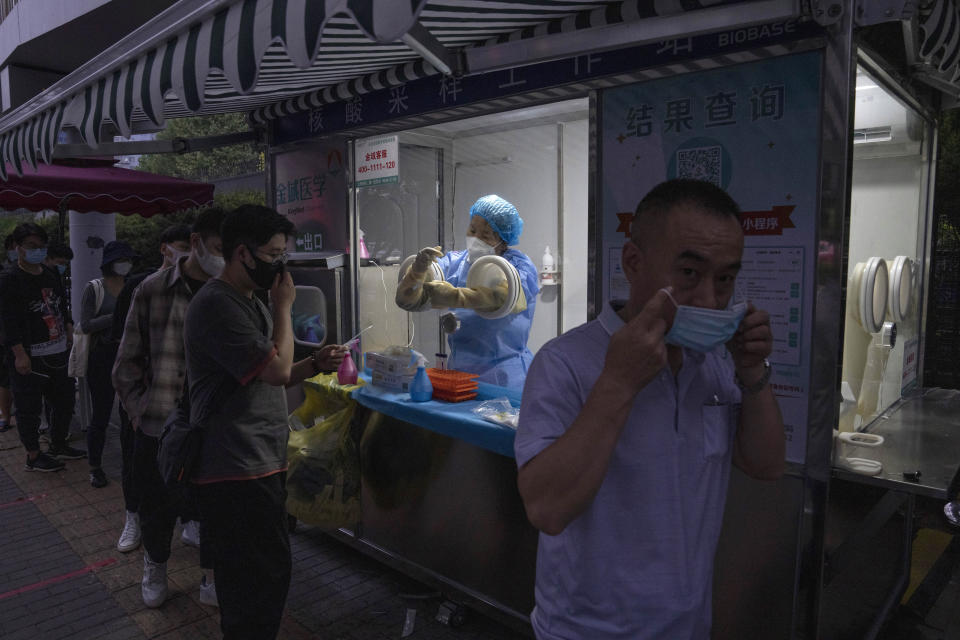 """A man masks himself after getting a nuclei test for COVID-19 in Beijing Saturday, Sept. 18, 2021. China's """"zero tolerance"""" strategy of trying to isolate every case and stop transmission of the coronavirus has kept kept the country where the virus first was detected in late 2019 largely free of the disease. (AP Photo/Ng Han Guan)"""