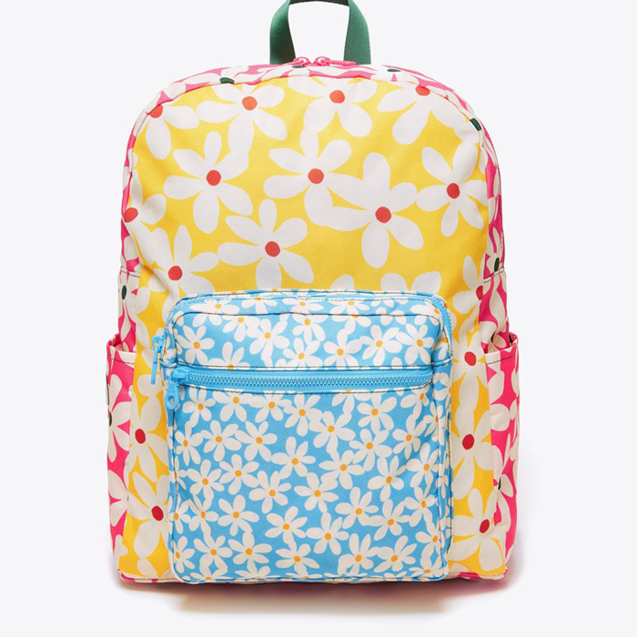 """This cheerful school bag is made for sunny days. $50, Bando. <a href=""""https://www.bando.com/collections/backpack/products/go-go-backpack-daisies"""" rel=""""nofollow noopener"""" target=""""_blank"""" data-ylk=""""slk:Get it now!"""" class=""""link rapid-noclick-resp"""">Get it now!</a>"""