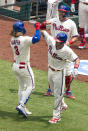 Philadelphia Phillies' Bryce Harper, left, celebrates his three-run home run with J.T. Realmuto, right, during the first inning of a baseball game against the Miami Marlins, Sunday, July 26, 2020, in Philadelphia. (AP Photo/Chris Szagola)