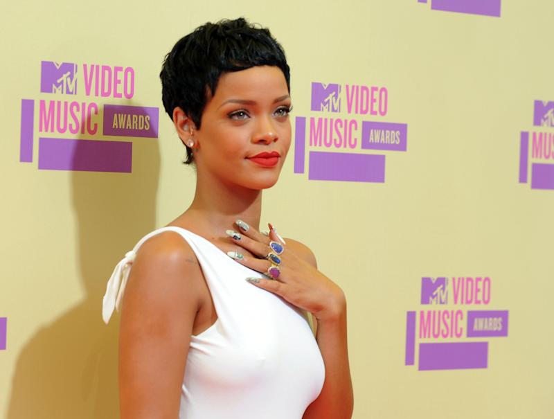 FILE - This Sept. 6, 2012 file photo shows video of the year winner Rihanna arriving at the MTV Video Music Awards  in Los Angeles. The 2013 MTV Video Music Awards will be held at the Barclays Center in the Brooklyn borough of New York on Sunday, Aug. 25, 2013. (Photo by Jordan Strauss/Invision/AP, file)