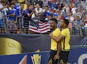 Jamaica forward Giles Barnes, left, celebrates his goal with Adrian Mariappa, right, against the Haiti during the first half of a CONCACAF Gold Cup soccer quarterfinal match, Saturday, July 18, 2015, in Baltimore. (AP Photo/Nick Wass)