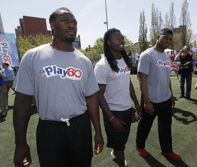 South Carolina's Jadeveon Clowney, left, Clemson's Sammy Watkins, center, and Buffalo's Khalil Mack participate in an NFL event in New York, Wednesday, May 7, 2014. The event was to promote Play 60, an NFL program which encourages kids to be active for a healthy life. (AP Photo/Seth Wenig)