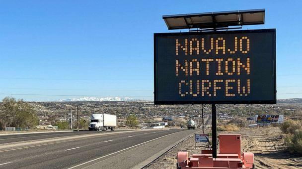 PHOTO: A road sign outside Bloomfield, N.M., warns Navajos to stay home during their nation's 8 p.m. to 5 a.m. curfew to slow the spread of the coronavirus, on April 7, 2020.  (Andrew Hay/Reuters)