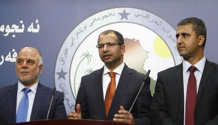 Salim al-Jabouri, new speaker of the Iraqi Council of Representatives, and deputy speakers address a news conference in Baghdad