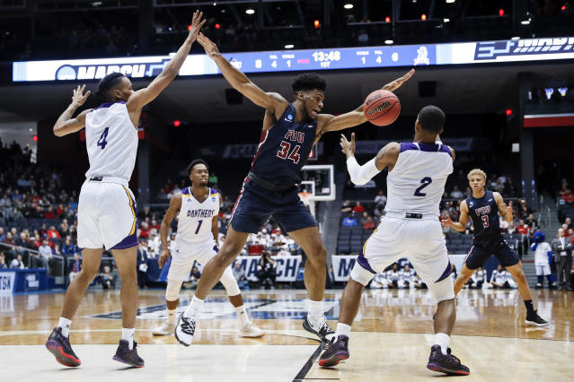 Prairie View A&M's Darius Williams (2) steals the ball from Fairleigh Dickinson's Mike Holloway Jr. (34) during the first half of a First Four game of the NCAA college basketball tournament, Tuesday, March 19, 2019, in Dayton, Ohio. (AP Photo/John Minchillo)