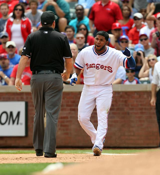 ARLINGTON, TX - MAY 12: Elvis Andrus #1 of the Texas Rangers argues a call with 1st base umpire Dan Belino after being called out at by 1st baseman Mark Trumbo #44 of the Los Angeles Angels of Anaheim on May 12, 2012 in Arlington, Texas. The Angels won 4-2. (Photo by Layne Murdoch/Getty Images)