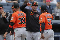 Baltimore Orioles manager Brandon Hyde (18) congratulates players after they defeated the New York Yankees in a baseball game, Saturday, March 30, 2019, in New York. The win was Hyde's first as a major league manager. (AP Photo/Julie Jacobson)