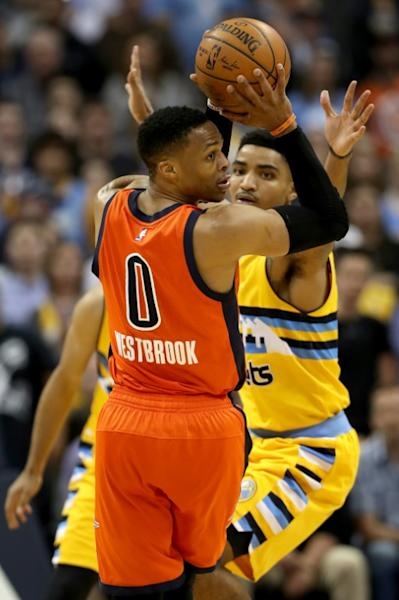 Russell Westbrook of the Oklahoma City Thunder looks for an outlet pass while being guarded by Gary Harris of the Denver Nuggets, at Pepsi Center in Denver, Colorado, on April 9, 2017