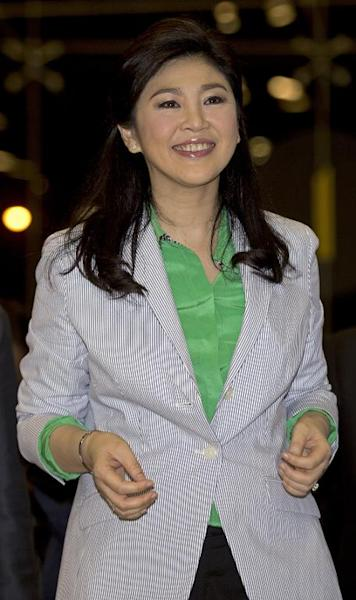 Thailand's deposed former prime minister Yingluck Shinawatra smiles as she arrives at the airport in Bangkok, July 23, 2014