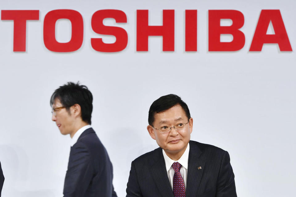 In this November 2018, photo, then Toshiba Corp., Chairman and CEO Nobuaki Kurumatani gets out of a seat after a press conference in Tokyo. Kurumatani stepped down Wednesday, April 14, 2021, a week after the Japanese technology and manufacturing conglomerate said it was studying an acquisition proposal from a global fund where he previously worked. Kurumatani tendered his resignation at a board meeting, and the board accepted, effective Wednesday, Tokyo-based Toshiba said in a statement. (Yoshitaka Sugawara/Kyodo News via AP)