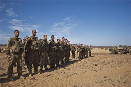French soldiers stand in formation during a patrol in the Tigharghar valley, about 100 km south of the town of Tessalit in northern Mali